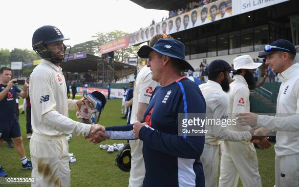 England coach Trevor Bayliss congratulates man of the series Ben Foakes during Day Four of the Third Test match between Sri Lanka and England at...