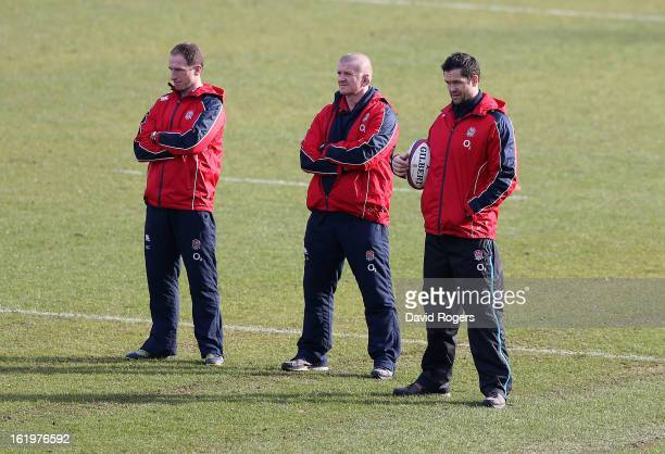 England coaches Mike Catt Graham Rowntree and Andy Farrell look on during the England training session held at Pennyhill Park on February 18 2013 in...