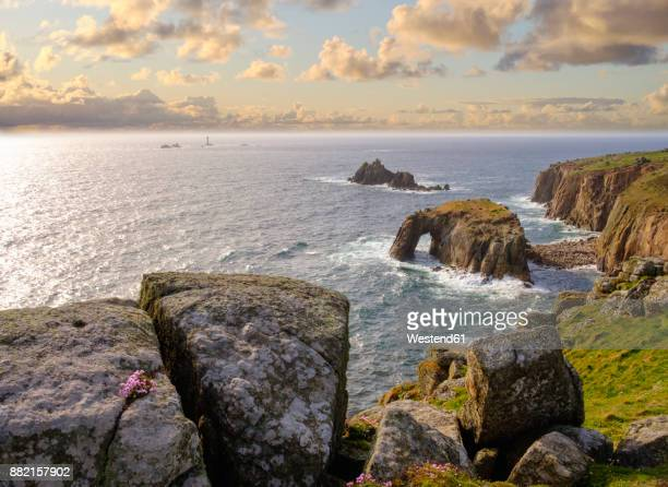 UK, England, Cornwall, Land's End, cliff coast with Enys Dodman Rock and Longships Lighthouse in background