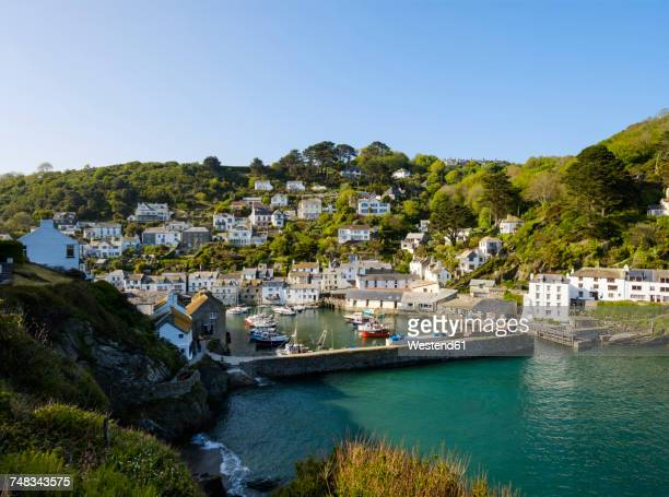 uk, england, cornwall, polperro, fishing harbor with retaining wall - fishing village stock pictures, royalty-free photos & images