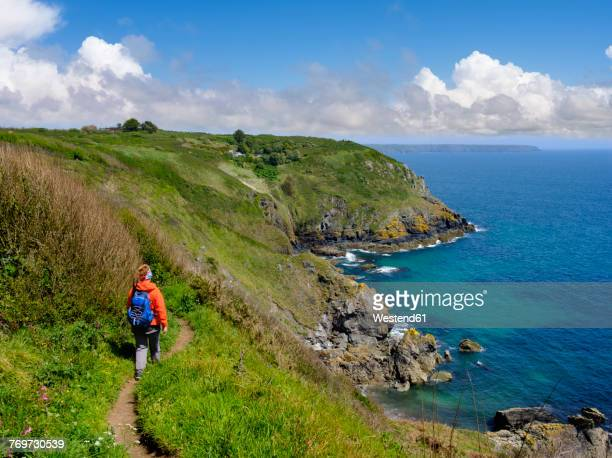 uk, england, cornwall, the lizard, woman hiking at the coast near cadgwith - coastline stock pictures, royalty-free photos & images