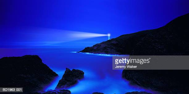 england, cornwall, trevose head, illuminated lighthouse and coast - lighthouse stock pictures, royalty-free photos & images