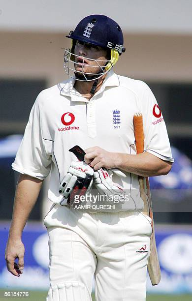 England cricket Andrew Flintoff walks back to the pavillion after he was dismissed by Pakistani bowler Shoaib Akhtar during the third day of the...