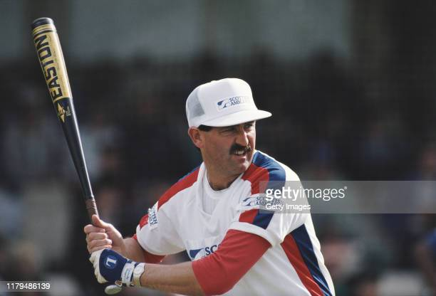 England cricket batsman Graham Gooch tries his hand at batting in Baseball during an event at the Oval Cricket ground on September 25 1988 in London...