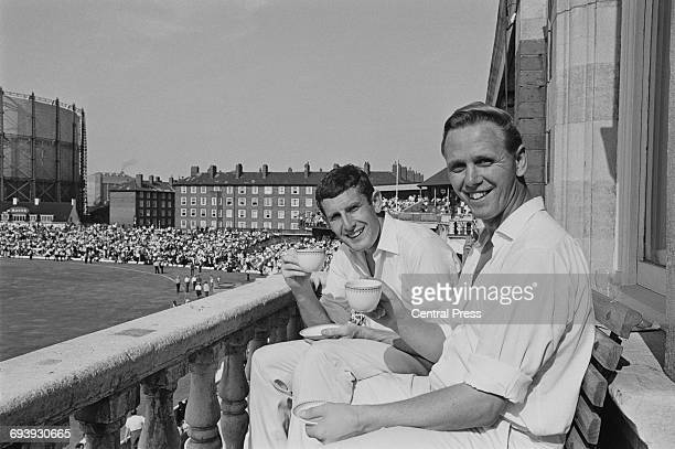 England cricket bowlers John Snow and Ken Higgs enjoy a cup of tea after their recordbreaking 128run last wicket stand against the West Indies in the...