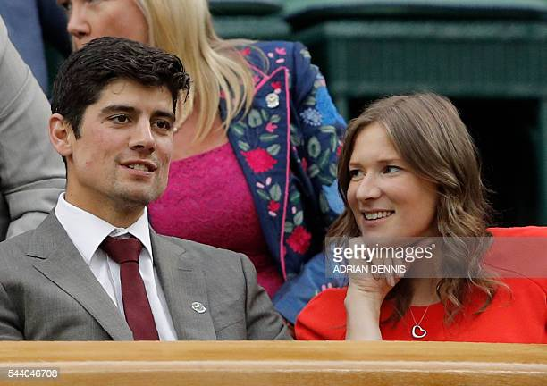 England cricket captain Alastair Cook and his wife Alice look on from the Royal box on centre court on the fifth day of the 2016 Wimbledon...