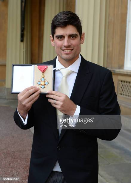 England cricket captain Alastair Cook poses for a photo after being awarded a CBE by the Prince of Wales at an Investiture ceremony at Buckingham...