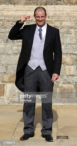England cricket captain Andrew Strauss poses with his OBE received from the Princess Royal during an investiture ceremony at Windsor Castle on...