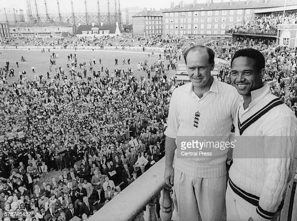 England cricket captain Brian Close and West Indies captain Garfield Sobers on the balcony of the pavillion at The Oval , London, after England won...
