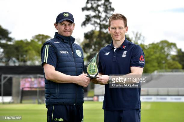 England cricket captain Eoin Morgan and Ireland cricket captain William Porterfield pose with the ODI Trophy as they attend the media day at Malahide...