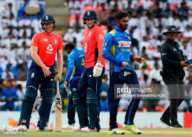 England cricket captain Eoin Morgan and Joe Root look on during the fourth one day international cricket match between Sri Lanka and England at the...