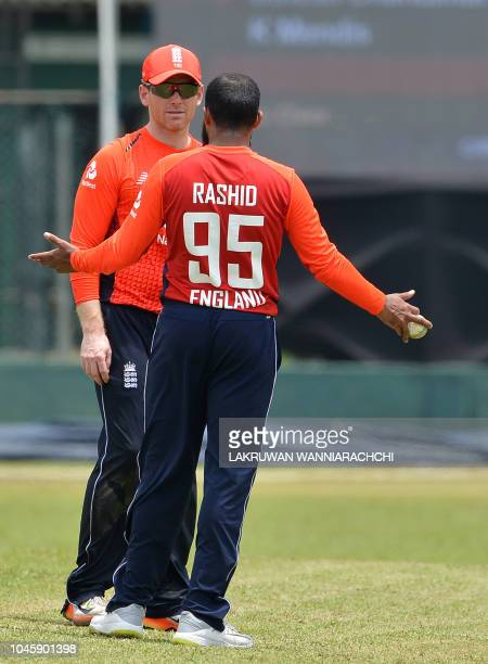 England cricket captain Eoin Morgan speaks with Adil Rashid during the practice match between the Sri Lanka Board XI and England team at the P Sara...