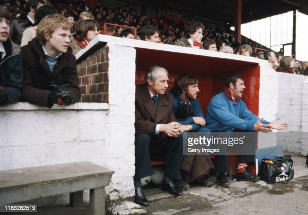 England cricket captain Ian Botham of Scunthorpe United looks on as a substitute with manager Ron Ashman during the League Division Four match...