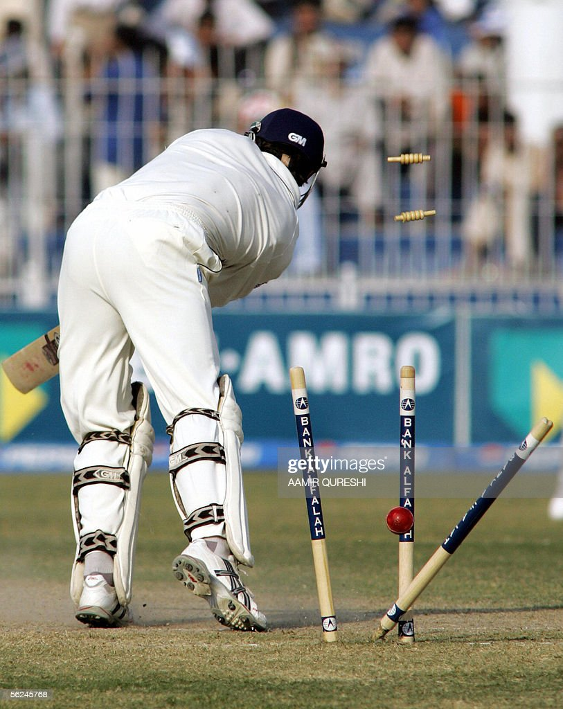 England cricket captain Michael Vaughan is bowled out by Pakistani bowler Rana Naved-ul-Hasan during the second day of the second Test match between Pakistan and England at The Iqbal Cricket Stadium in Faisalabad, 21 November 2005. Pakistan were bowled out for 462 in their first innings, in reply England are 54 runs for the loss of two wickets as the afternoon session continues. AFP PHOTO/Aamir QURESHI