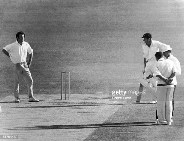 England cricket captain Ray Illingworth talks to umpire Lou Rowan after Rowan had warned bowler John Snow over bowling too many shortpitched...
