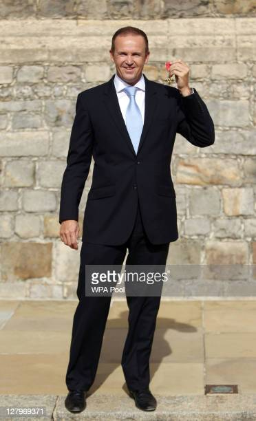 England cricket coach Andy Flower poses with his OBE received from the Princess Royal during an investiture ceremony at Windsor Castle on October 4...