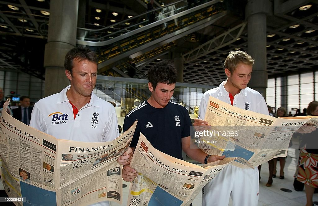 England Cricket players (L-R) Graeme Swann, Craig Kieswetter and Stuart Broad catch up on the latest financial news during a visit to Lloyds of London as guests of Brit Insurance on May 24, 2010 in London, England.