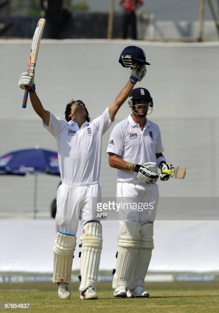 England cricket team captain Alastair Cook reacts after scoring a century as teammate Kevin Pietersen looks on during the first day of play in the...