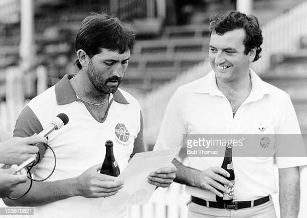 England cricket team captain Graham Gooch reads a prepared statement about their 'rebel tour' to South Africa watched by tour orangiser Peter Cooke...