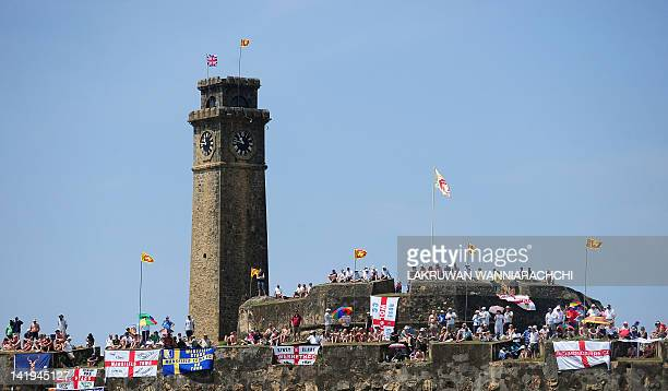 England cricket team fans watch the second day of the opening Test Match between Sri Lanka and England from the top of the 14th century Dutch fort...