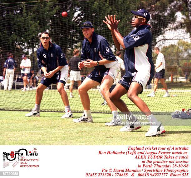 England cricket tour of Australia Ben Hollioake and Angus Fraser watch as ALEX TUDOR Takes a catch at the practice net session in Perth Thursday...
