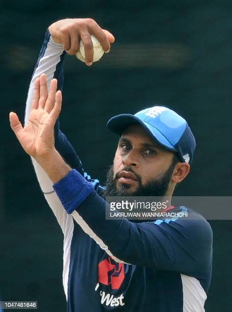 England cricketer Adil Rashid delivers a ball during a practice session at the Rangiri Dambulla International Cricket Stadium in Dambulla on October...