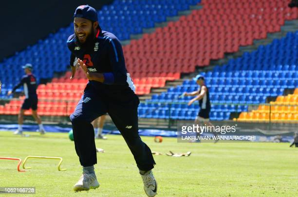 England cricketer Adil Rashid warms up during a practice session at the Pallekele International Cricket Stadium in Pallekele on October 15 2018...