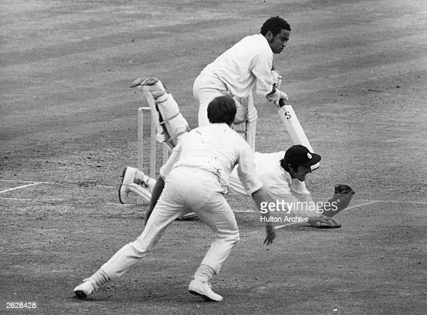 England cricketer Alan Knott taking a diving catch at the Oval London Original Publication People Disc HG0034