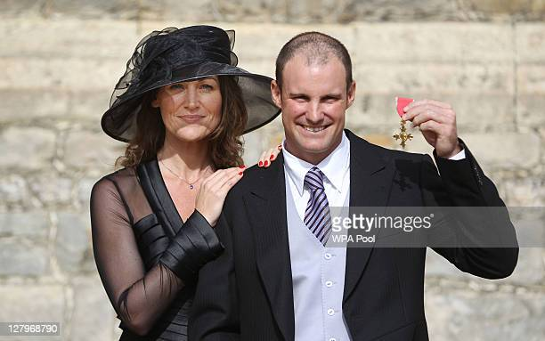 England cricketer Andrew Strauss with his wife Ruth pose with his OBE he received from the Princess Royal during an Investiture ceremony at Windsor...
