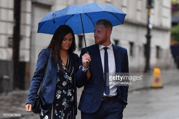 England cricketer Ben Stokes and his wife Clare arrive at Bristol Crown Court in Bristol southwest England on August 10 2018 for a hearing in his...