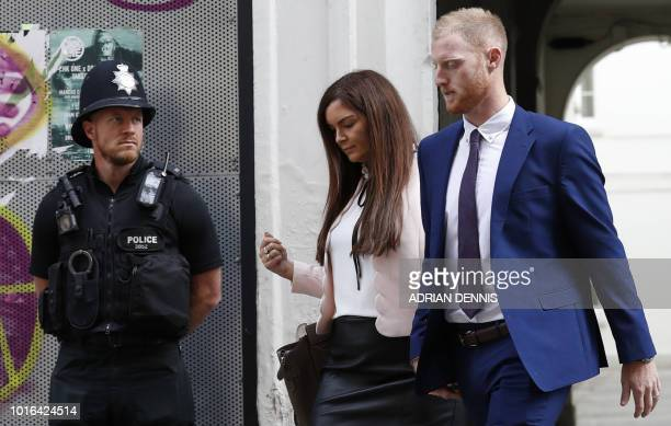 England cricketer Ben Stokes and his wife Clare arrive at Bristol Crown Court in Bristol southwest England on August 14 during his trial on charges...