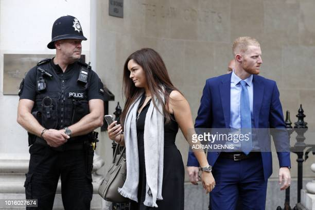 England cricketer Ben Stokes and his wife Clare leave Bristol Crown Court as the trial breaks for lunch in Bristol southwest England on August 13...