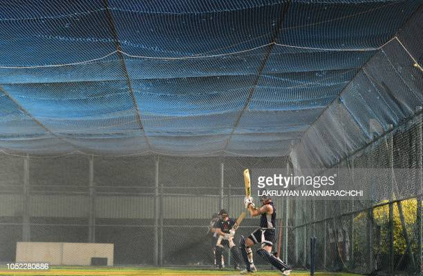 TOPSHOT England cricketer Ben Stokes bats during a practice session at the Pallekele International Cricket Stadium in Pallekele on October 16 2018...
