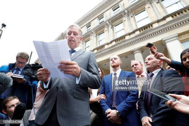 England cricketer Ben Stokes listens as a statement is read to members of the media after leaving from Bristol Crown Court in Bristol southwest...