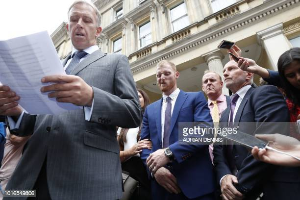 England cricketer Ben Stokes listens as a statement is read to members of the media outside Bristol Crown Court in Bristol southwest England on...