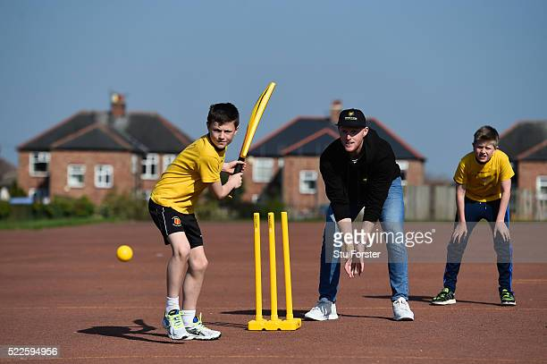 England cricketer Ben Stokes looks on as batsman George Darwood from Ravenswood primary school plays a shot at a Chance to Shine coaching session on...
