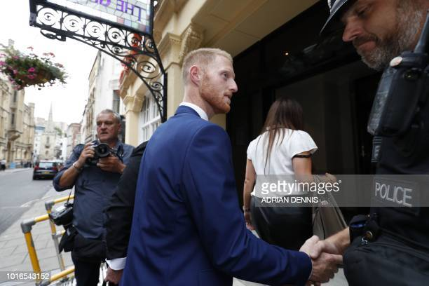 England cricketer Ben Stokes shakes hands with a police officer as he returns to his hotel after leaving from Bristol Crown Court in Bristol...