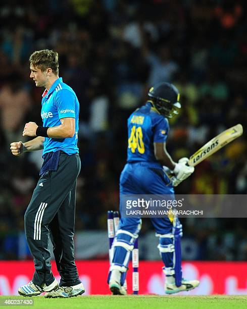 England cricketer Chris Woakes celebrates after he dismissed Sri Lankan cricketer Ajantha Mendis during the fifth One Day International match between...