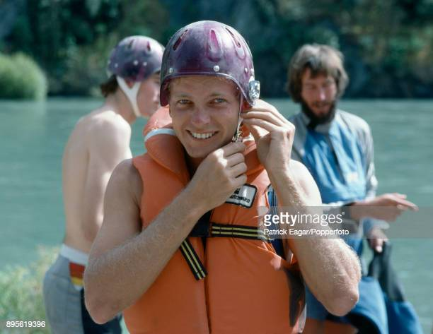 England cricketer David Gower adjusts his helmet before going whitewater rafting on the Kawarau River in Central Otago New Zealand before the 3rd...