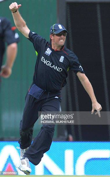 England cricketer Graeme Swann celebrates after taking a catch of Australian cricketer Shane Watson during the Men's ICC World Twenty20 final match...