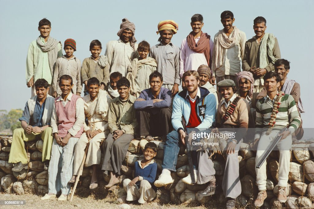 England cricketer Ian Botham pictured with local Indian beaters on a Partridge Game shoot whilst on the England Cricket Tour to India 1981/82.
