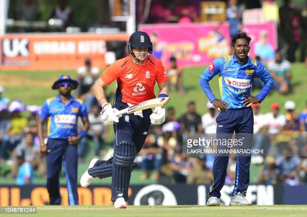 England cricketer Joe Root runs between the wickets as Sri Lankan cricketer Akila Dananjaya looks on during the first one day international cricket...