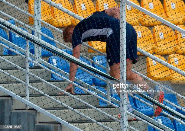 England cricketer Jonny Bairstow reacts as he walks of the field after being injured while playing soccer with his teammates during a practice...