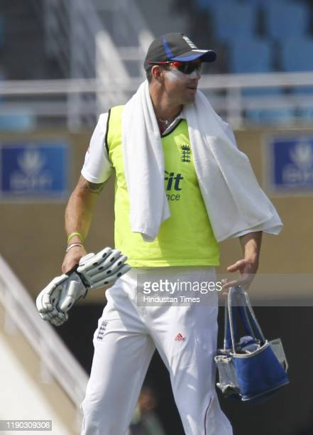 England cricketer Kevin Pietersen carries drinks for teammates during the day one of the cricket practice match between Mumbai 'A' and England at the...