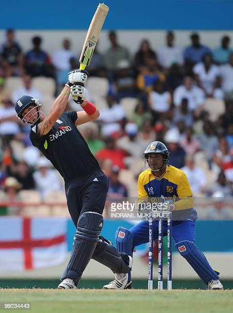 England cricketer Kevin Pietersen watched by Sri Lankan captain Kumar Sangakkara plays a shot during the ICC World Twenty20 first semifinal match...