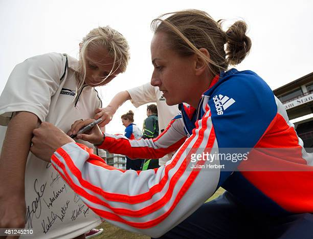 England cricketer Laura Marsh signs a fans shirt at the launch of The Women's Ashes Series at The County Ground on July 18 2015 in Taunton England