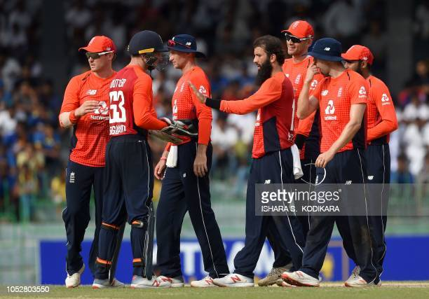 England cricketer Moeen Ali celebrates with teammate after he dismissed Sri Lankan cricketer Sadeera Samarawickrama during the fifth and final one...