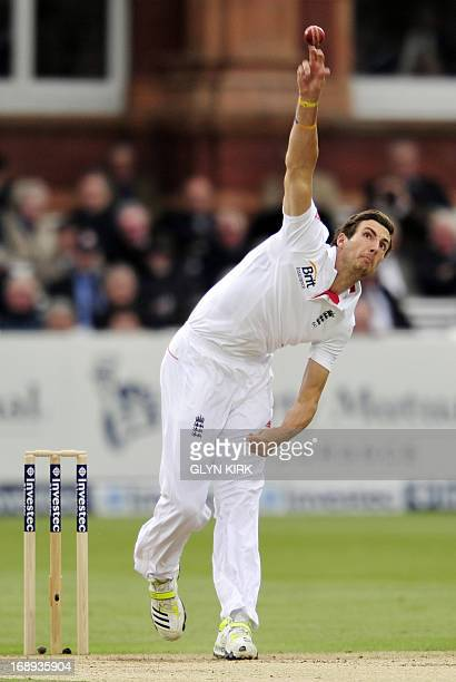 England cricketer Steven Finn delivers a ball during the second day of the first International Test cricket match between England and New Zealand at...