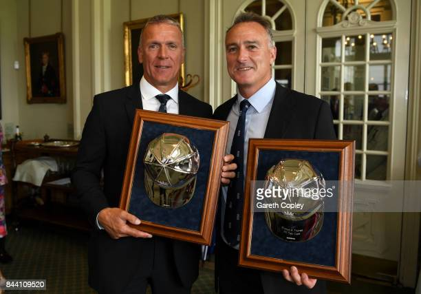 England cricketers Alec Stewart and Graham Thorpe pose with their silver caps commemorating reaching 100 test caps for England during the lucnch...