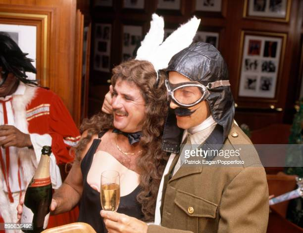 England cricketers Allan Lamb and David Gower in fancy dress for their Christmas lunch in Melbourne Australia 25th December 1990